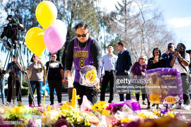 Ralf u201cCobyu201d Boncocan of Oxnard leaves flowers and a candle for his u201cSuper Herou201d Kobe Bryant and his 13yearold daughter at Mamba...