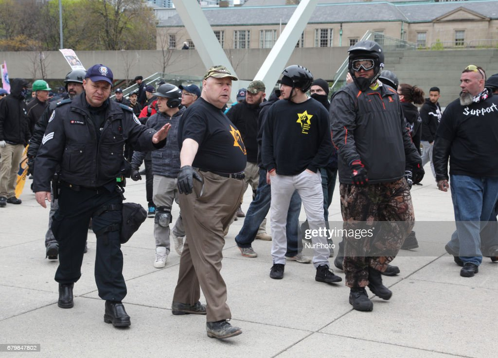 Rally against Islam, Muslims, and Sharia Law in downtown Toronto, Ontario, Canada, on May 06, 2017. Groups such as the Concerned Coalition of Canadian Citizens, the Soldiers of Odin, and the Jewish Defense League rallied to protest against Islam, Muslims, and Sharia Law. The groups blame Muslims and 'Sharia Law' for unemployment, austerity and social cuts.