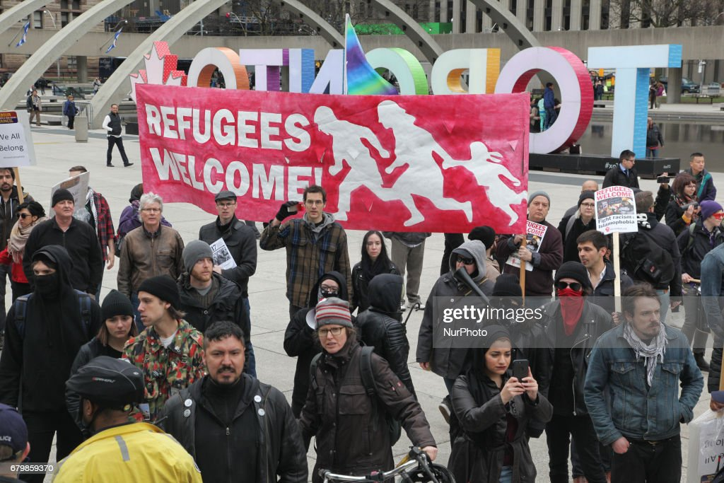 Rally against Islamophobia, White Supremacy & Fascism in downtown Toronto, Ontario, Canada, on May 06, 2017. Protesters clashed with anti-Muslim and fascist groups while hundreds of police officers were deployed to maintain control. Groups such as the Concerned Coalition of Canadian Citizens, the Soldiers of Odin, and the Jewish Defense League blame Muslims and 'Sharia Law' for unemployment, austerity and social cuts.