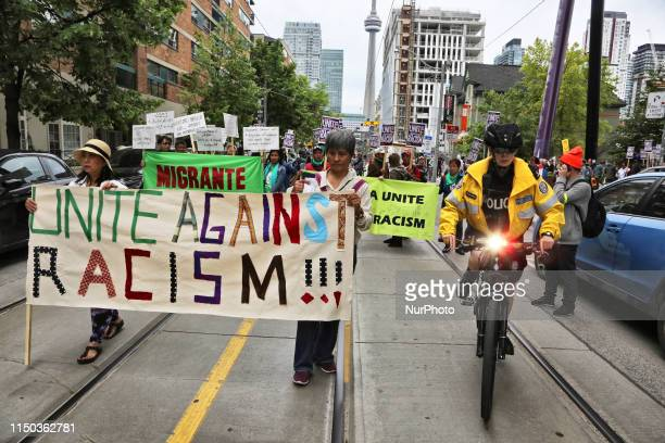 Rally against racism and support for migrant workers rights in downtown Toronto Ontario Canada on June 16 2019 The Unite Against Racism Rally in...