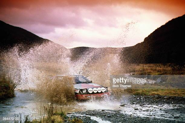 Rally car crossing ford