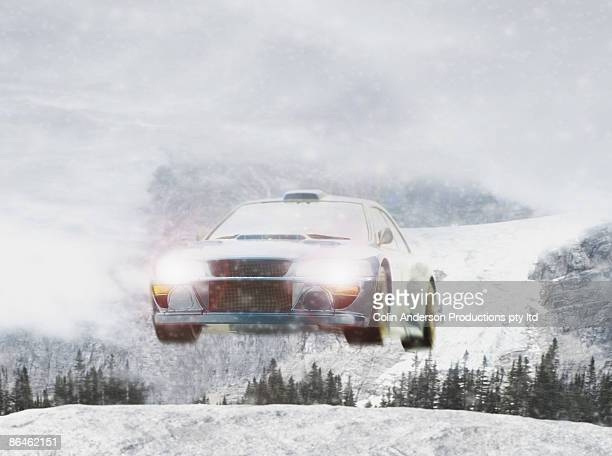 rally car flying through air - rally car stock photos and pictures