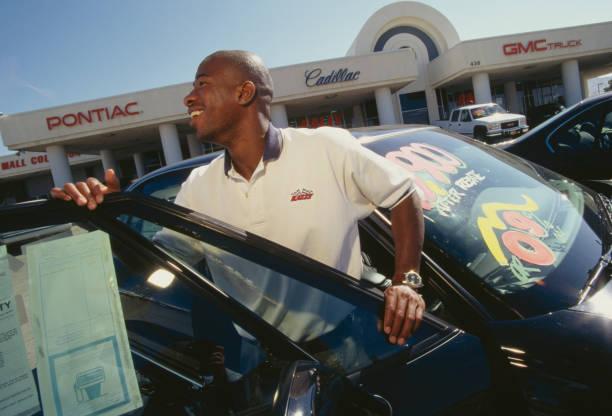 Rally Chevrolet Pontiac Dealership Salesman Smiling with Car