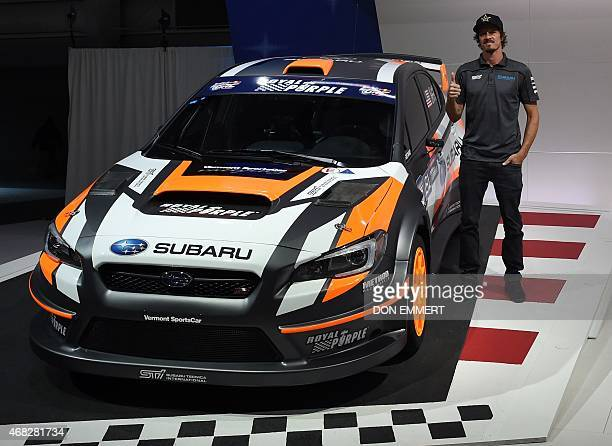Rally driver Bucky Lasek stands next to his Subaru WRX STI at the Subaru news conference at the 2015 New York Auto Show April 1 2015 at the Javits...