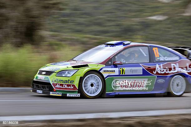 Rally driver of the BP Ford WRT Kalid Al Qassimi from United Arab Emirates and his navigator Michael Orr from Ireland steer their Ford Focus RS WRC...