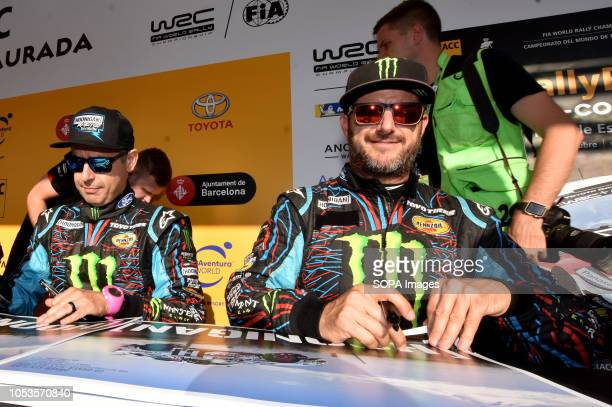 Rally drivers Alex Gelsomino and Ken Block seen signing an autographs to their fans before the asphalt stage in Barcelona during the RACC Catalunya...