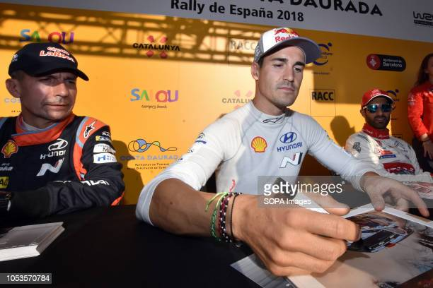 Rally drivers Carlos del Barrio and Dani Sordo seen signing an autographs to their fans before the asphalt stage in Barcelona during the RACC...