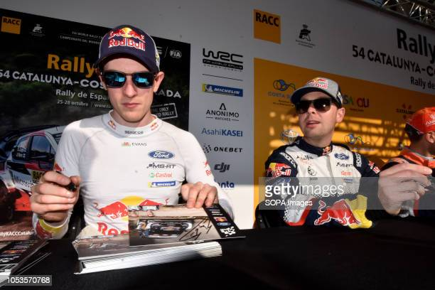 Rally drivers Elfyn Evans and Daniel Barrit seen signing an autographs to their fans before the asphalt stage in Barcelona during the RACC Catalunya...