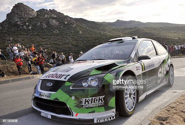 Rally drivers from Stobart WRT Matthew Wilson of Great Britain and his teammate and compatriot Scott Martin steer their Ford Focus RS WRCduring a...