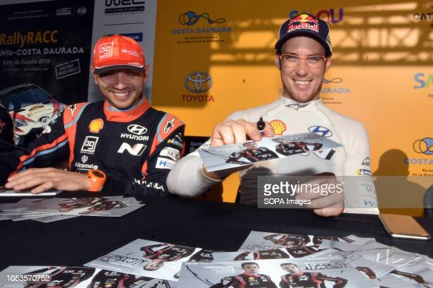 Rally drivers Nicolas Gilsoul and Thierry Neuville seen signing an autographs to their fans before the asphalt stage in Barcelona during the RACC...