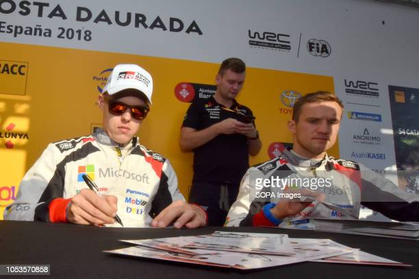 Rally drivers Ott Tänak and Martin Järveoja seen signing an autographs to their fans before the asphalt stage in Barcelona during the RACC Catalunya...