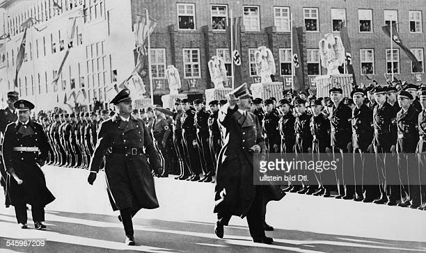 Rally in Wilhelmshaven on the occasion of the launch of the German battleship 'Tirpitz' Adolf Hitler is taking the salute of an SA guard of honour...
