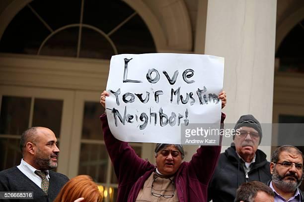 Rally member holding handlettered sign aloft exhorting love for Muslim neighbors City council speaker Melissa MarkViverito led an interfaith rally of...