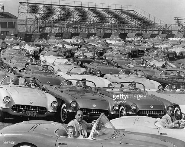 A rally of car enthusiasts in New York all driving 1950's Corvette Convertible Stingrays made by Chevrolet