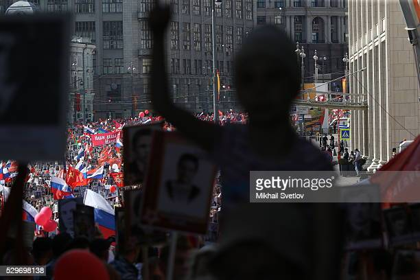 Rally of the people carrying portraits of relatives who fought in World War II during the Immortal Regiment march in Red Square in Moscow Russia May...