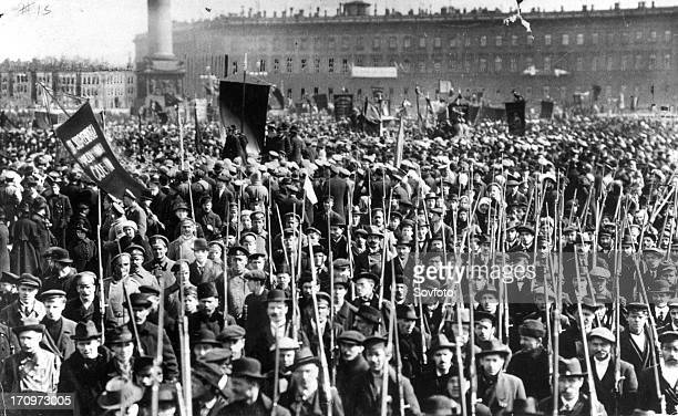 A rally of thousands of russian soldiers and civilians in front of the winter palace in petrograd protected by the red guard who are shown in the...