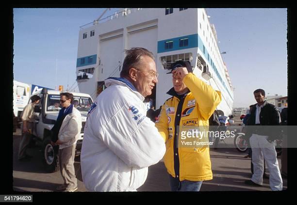 Rally organizer Gilbert Sabine and Peugeot pilot Ari Vatanen have a conversation during the 12th ParisDakar rally in Tripoli Gilbert Sabine took over...