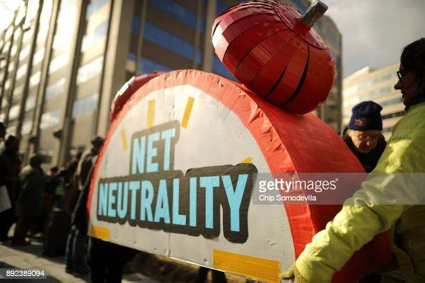 Rally organizers carry away props following a protest outside the Federal Communication Commission building against the end of net neutralityrules...