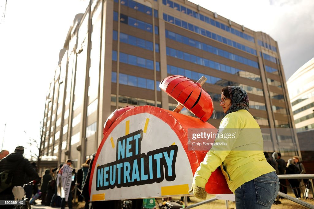 Rally organizers carry away props following a protest outside the Federal Communication Commission building against the end of net neutralityrules December 14, 2017 in Washington, DC. Lead by FCC Chairman Ajit Pai, the commission is expected to do away with Obama Administration rules that prevented internet service providers from creating different levels of service and blocking or promoting individual companies and organizations on their systems.