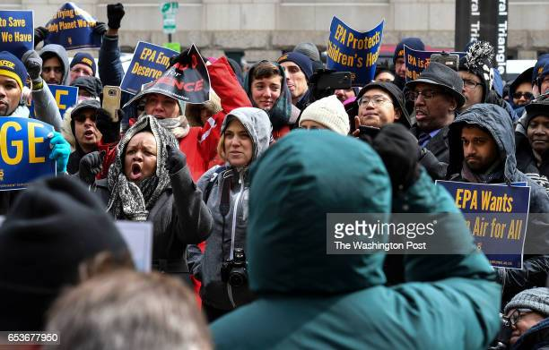 Rally participants cheer as Rep Keith Ellison speaks to union members of American Federation of Government Employees and environmental groups during...