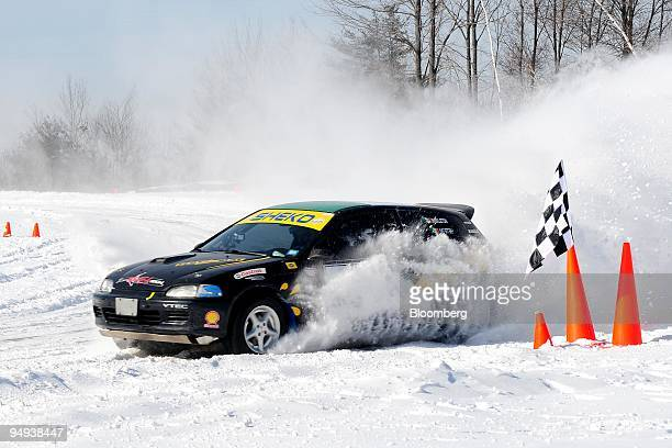 A rally tuned Honda turns out of a snow bank on the racetrack at Monticello Motor Club in Monticello New York US on Saturday Jan 17 2009 The track...