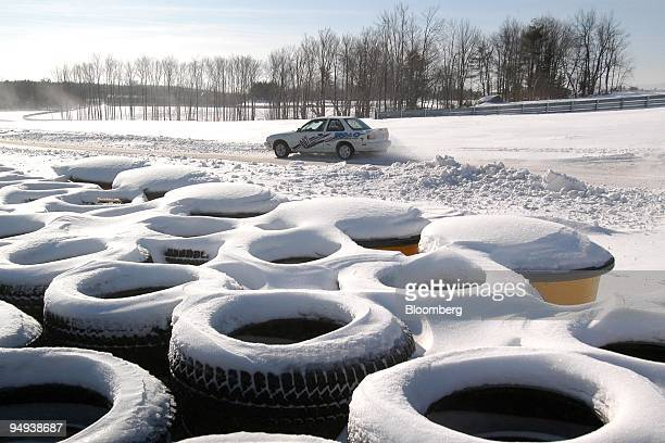 Rally tuned Nissan makes its way through snow and ice on the track at Monticello Motor Club in Monticello, New York, U.S., on Saturday, Jan. 17,...