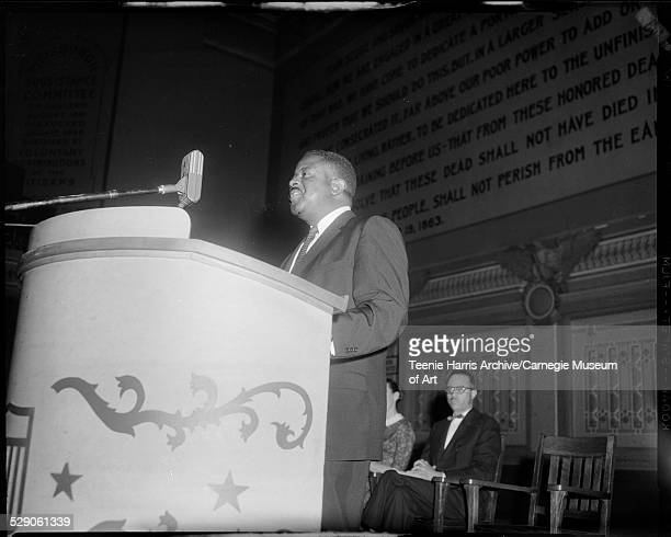 Ralph Abernathy standing at podium in Soldiers and Sailors Memorial Hall with Rev LeRoy Patrick in background Pittsburgh Pennsylvania circa 19601969