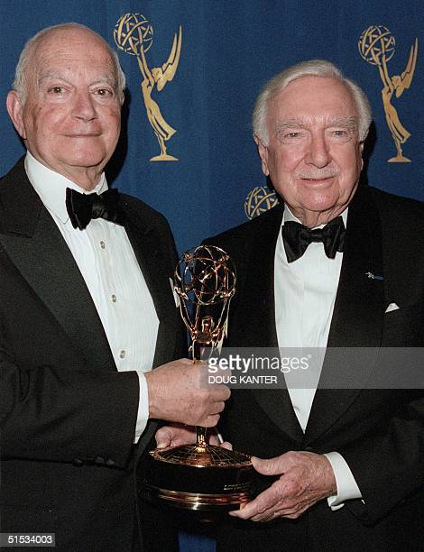 Ralph Baruch poses with former US television journalist Walter Cronkite at the 27th Annual International Emmys in New York 22 November 1999 Cronkite...