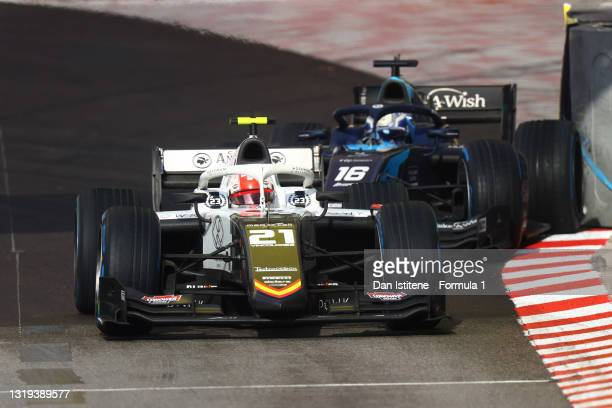 Ralph Boschung of Switzerland and Campos Racing drives as Roy Nissany of Israel and DAMS crashes into the wall behind during Sprint Race 2 of Round...