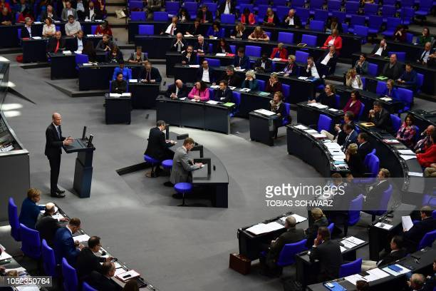 Ralph Brinkhaus leader of the conservative CDU/CSU parliamentary group addresses the Bundestag the lower house of parliament on October 17 2018 in...