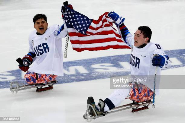 Ralph Dequebec and Jack Wallace of the United States celebrate the gold medal after winning in the Ice Hockey gold medal game between United States...