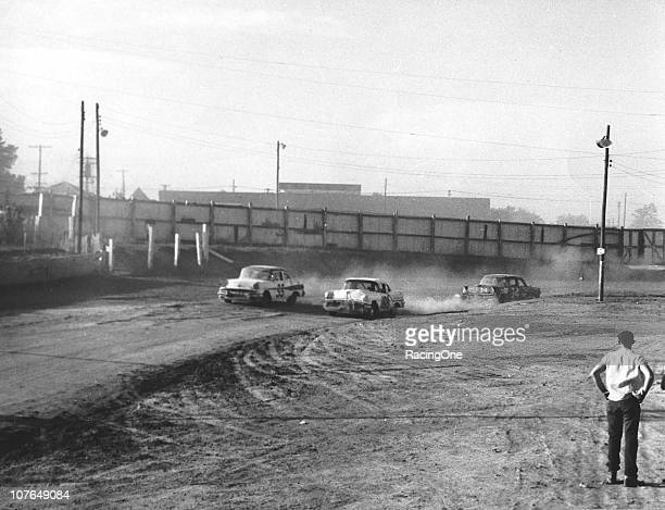 Ralph Earnhardt driving a Petty Enterprises Oldsmobile battles sidebyside with Tiny LundÕs Pontiac during a NASCAR Cup race at the Greensboro...
