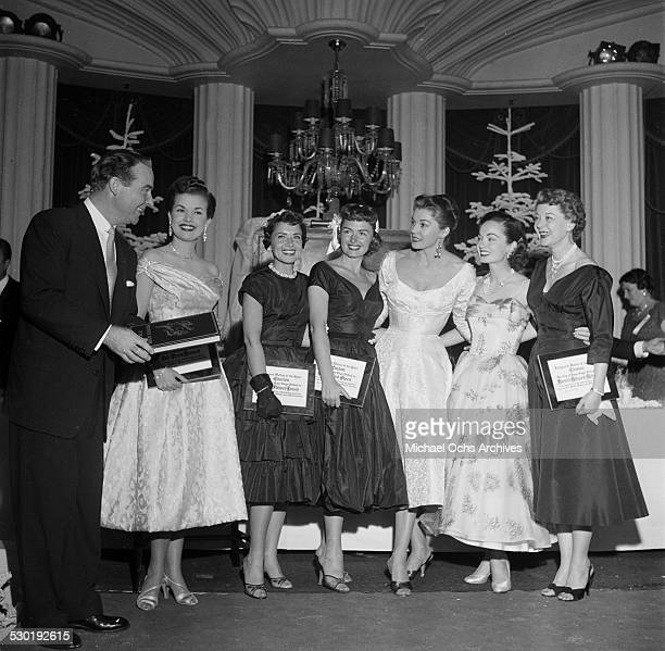 Ralph Edwards Gale Storm Patty Lewis Donna Reed Esther Williams Ann Blyth and Harriet Hilliard Nelson pose during the Mother of the Year event in Los...