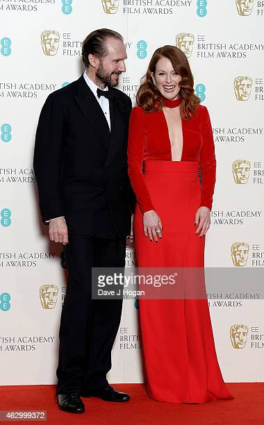 Ralph Fiennes and Julianne Moore pose in the winners room at the EE British Academy Film Awards at The Royal Opera House on February 8 2015 in London...