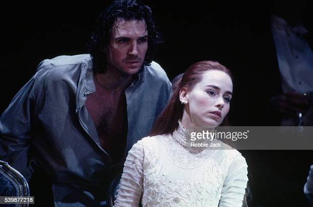 Ralph Fiennes and Tara Fitzgerald portray Hamlet and Ophelia during the playwithinaplay scene of an Almeida Theatre production of Hamlet