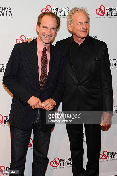 Ralph Fiennes and Victor Garber attend the dinner and auction benefiting Friends in Deed hosted by Andy Cohen at Stephan Weiss Studio on October 6...