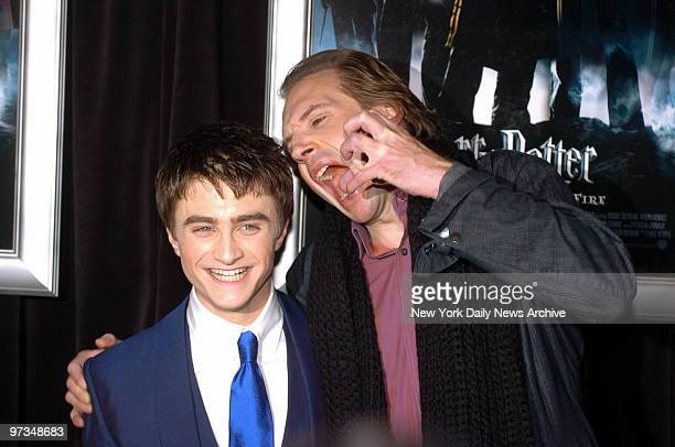 Ralph Fiennes clowns around with Daniel Radcliffe during the New York premiere of Harry Potter and the Goblet of Fire at the Ziegfeld Theatre on W...