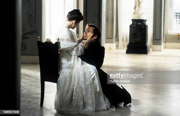 Ralph Fiennes down on his knee in front of Liv Tyler in a scene from the film 'Onegin' 1999