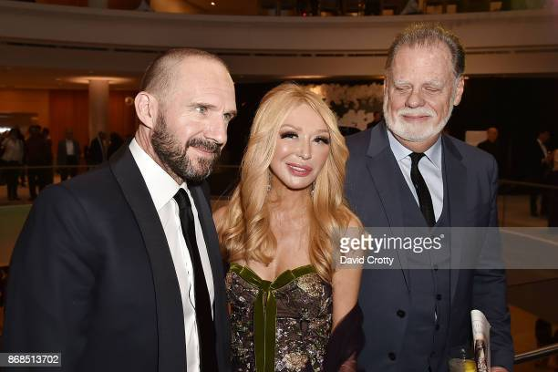 Ralph Fiennes Elizabeth Segerstrom and Taylor Hackford attend the Mariinsky Orchestra Concert in honor of Henry Segerstrom and the 50th anniversary...