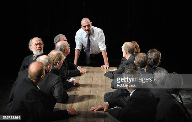 Ralph Fiennes performs with artists of the company in the National Theatre's production of Sophocles's play Oedipus in a new version by Frank...