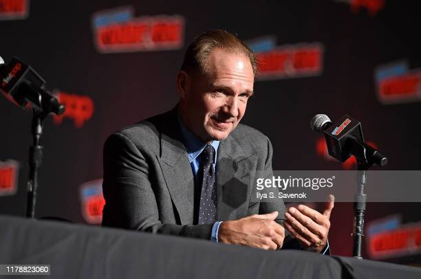"""Ralph Fiennes speaks onstage during """"The King's Man"""" at New York Comic Con at The Jacob K. Javits Convention Center on October 03, 2019 in New York..."""
