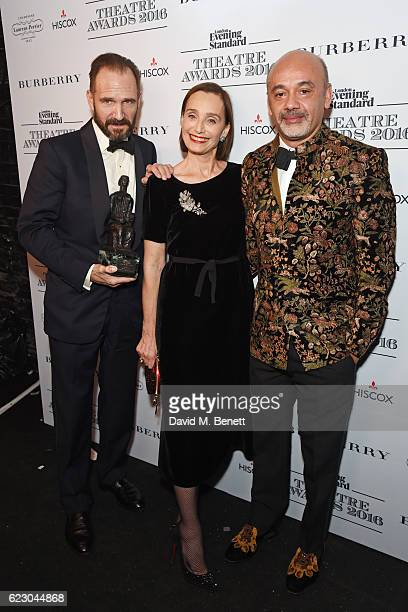 Ralph Fiennes winner of the Best Actor award Dame Kristin Scott Thomas and Christian Louboutin pose in front of the winners boards at The 62nd London...