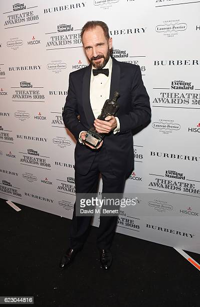 Ralph Fiennes winner of the Best Actor award poses in front of the winners boards at The 62nd London Evening Standard Theatre Awards recognising...