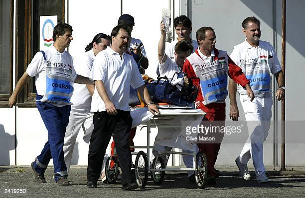 Ralph Firman of Great Britain and Jordan is wheeled away on a stretcher after an accident during second practice for the Formula One Hungarian Grand...