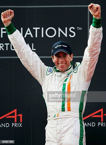Ralph Firman of Ireland celebrates taking 3rd place in the A1 Grand Prix of Nations Feature race at the Circuito Estoril on October 23 2005 in...