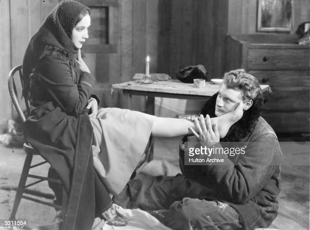 Ralph Forkes worships Dolores Del Rio's foot, in the film, 'The Trail of '98'.