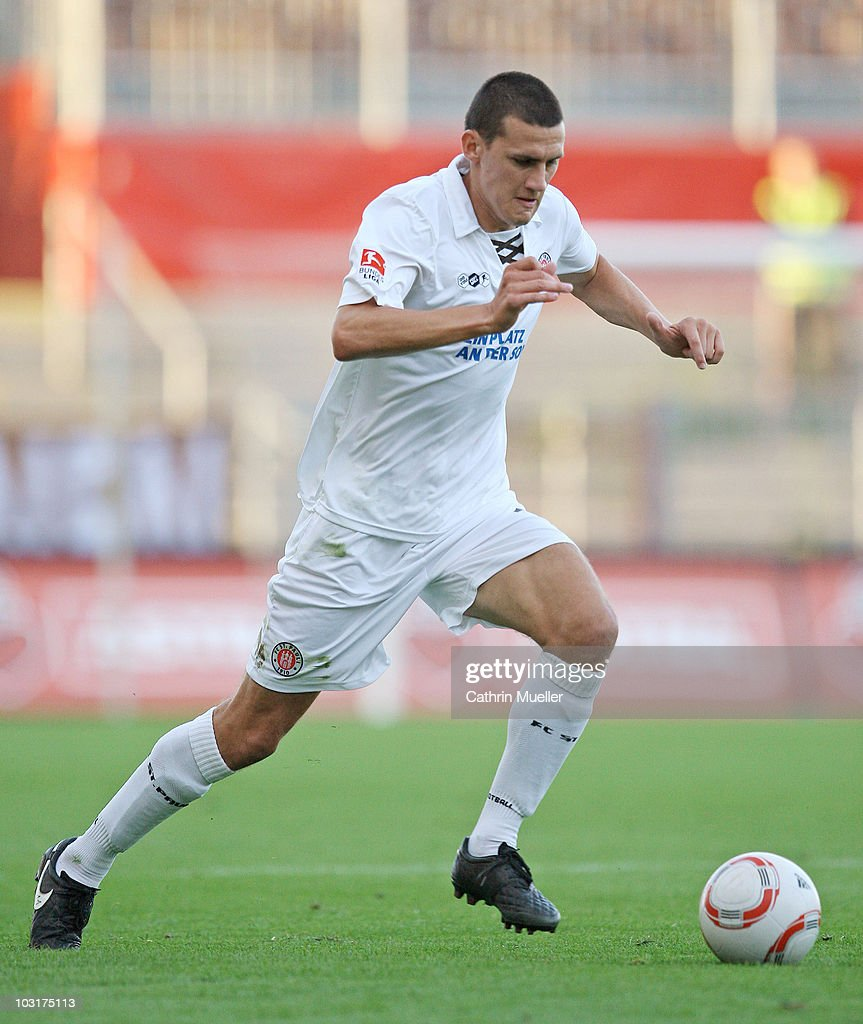 Ralph Gunesch of FC St. Pauli runs with the ball during the pre-season friendly match against Racing Santander at Millerntor Stadium on July 30, 2010 in Hamburg, Germany.