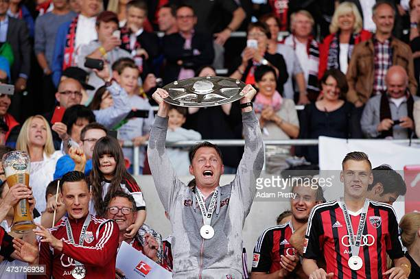 Ralph Hasenhuettl Head Coach of FC Ingolstadt celebrates with the shield after victory in the 2 Bundesliga match between FC Ingolstadt and RB Leipzig...