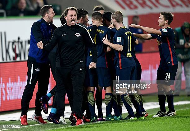 Ralph Hasenhuettl head coach of Leipzig celebrates during the Bundesliga match between VfL Wolfsburg and RB Leipzig at Volkswagen Arena on October 16...