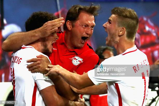 Ralph Hasenhuettl head coach of Leipzig celebrates the first team goal with his players during the Bundesliga match between RB Leipzig and Borussia...